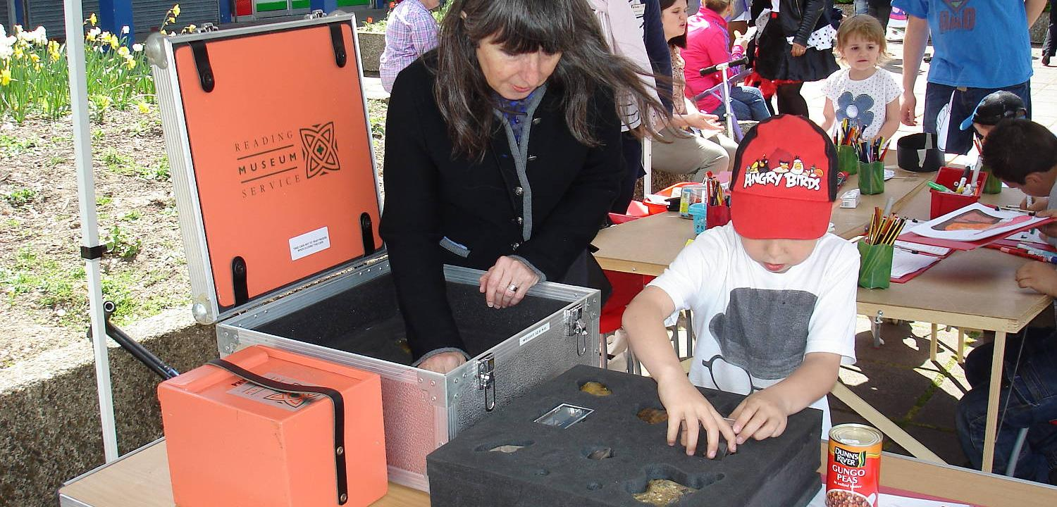 Child and volunteer at Happy Museum event