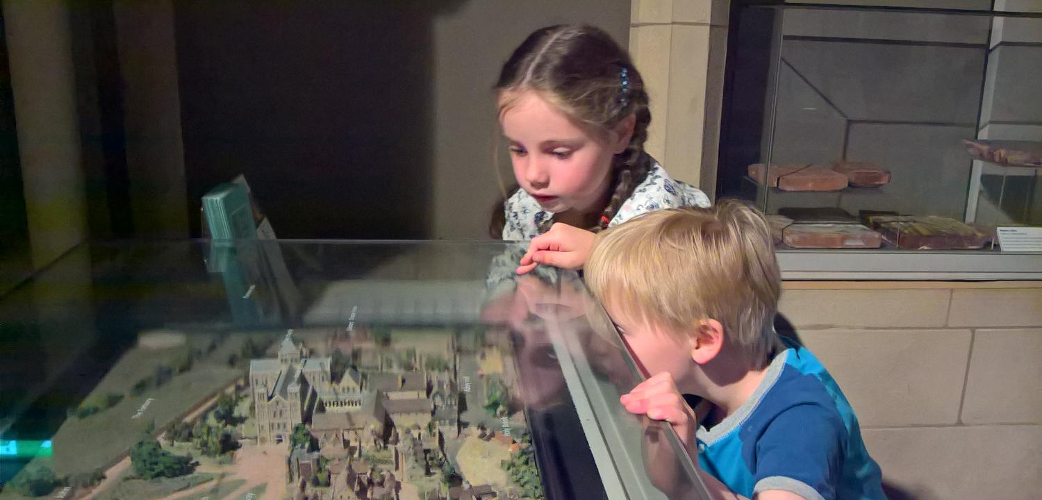 Children looking at the Reading Abbey model