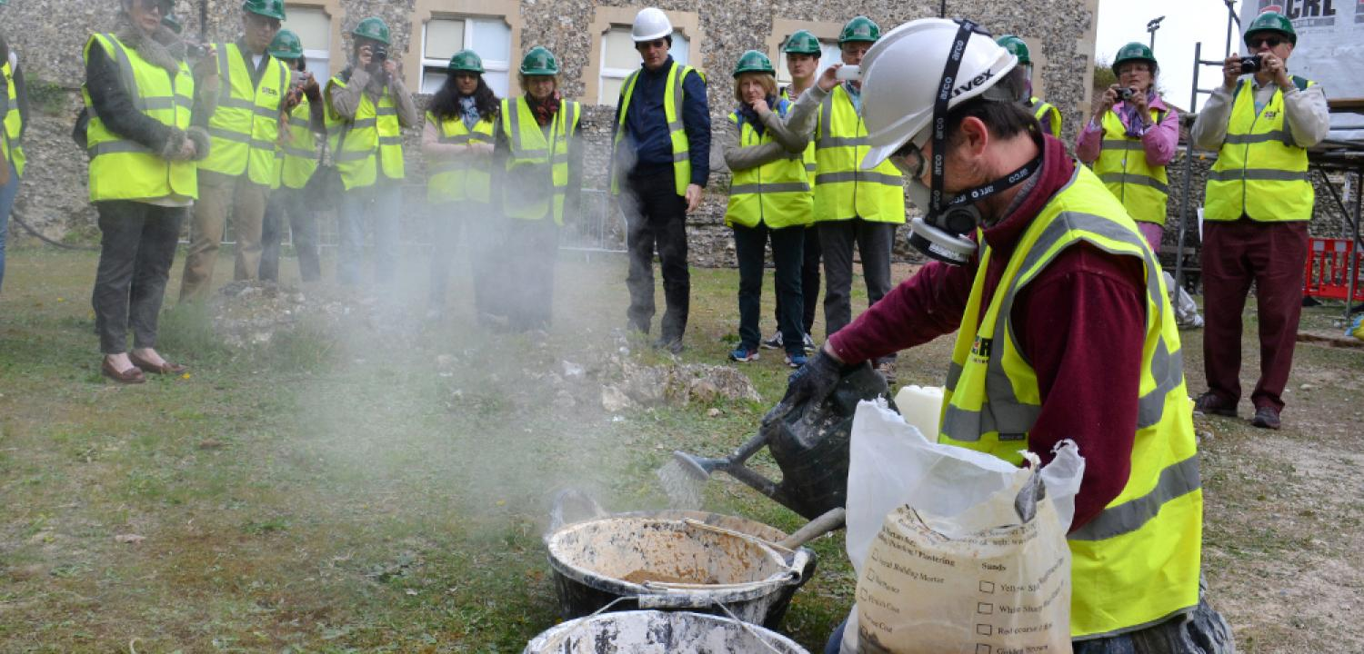 A demonstration of making hot-mix lime mortar.