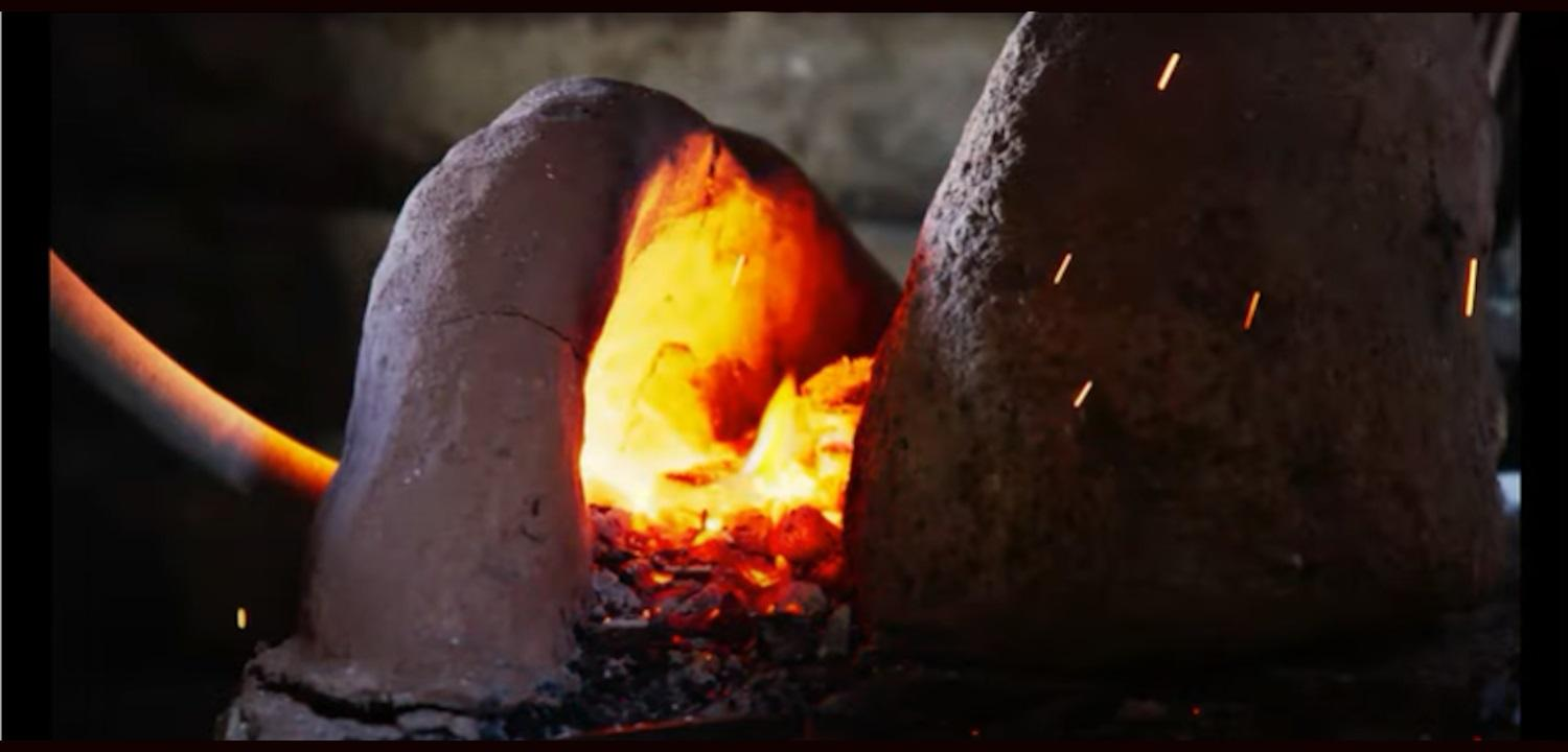 A red hot blacksmithing forge