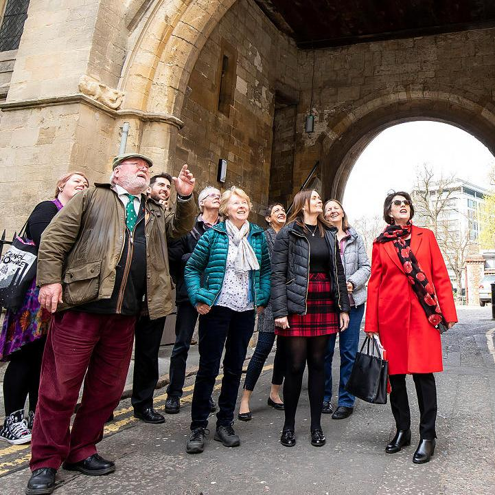 Visitors taking part in an Abbey Quarter tour