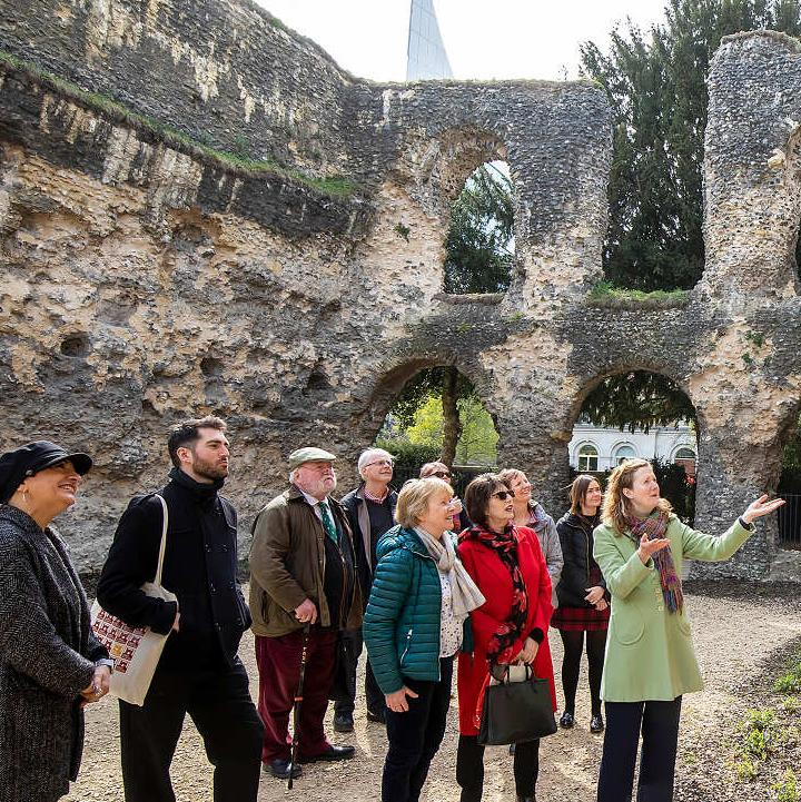 visitors on a tour in the abbey chapter house