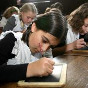 Children working in the Victorian schoolroom