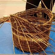 Woven basket with a stripe in lighter willow
