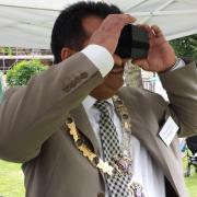 The Mayor of Reading trying on the Reading Abbey virtual reality headset